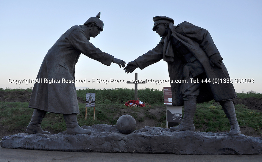 "25/12/14<br /> <br /> A sculpture depicting two WW1 soldiers playing football during the famous Christmas Day truce in the field near Messine, Belgium, close to where the match was played in Flanders, Belgium.<br /> <br /> The sculpture, made in England, arrived in Flanders on Christmas Eve, and was first displayed in the town centre before being taken to the spot where the match was played. <br /> <br /> Sculpted by Andy Edwards the work is entitled 'All Together Now', recalling the song by the band The Farm - which was inspired by the truce. <br /> <br /> Chris Butler said: ""Castle Fine Arts are proud to have cast a number of war memorials over the years. We are honoured to support this sculpture for peace. I believe it will touch the hearts of millions.""<br /> <br /> <br /> ""It will be a symbol of peace and hope and a call for a renewed worldwide cessation of violence in honour of those brave boys who 'joined together and decided not to fight'"".<br /> <br /> <br /> The statue depicts the meeting of a British and a German soldier over a football, deep in the mud between the lines on that first Christmas of the war. The soldiers appear to be shaking hands but  are not not quite touching, forming a space in which a visitor can insert their own hand to complete the union.  A chance for a moments reflection on how far we are from true peace and brotherhood and the part each of us has to play in that dream. We want the work to stand as both a celebration of this inspirational and heroic event and as symbol of hope and peace. <br /> <br /> The project was instigated some years ago, with the support of the Football Asscociation (FA), as football's contribution to the First World War commemorations. <br /> <br /> All Rights Reserved - F Stop Press. www.fstoppress.com. Tel: +44 (0)1335 300098"
