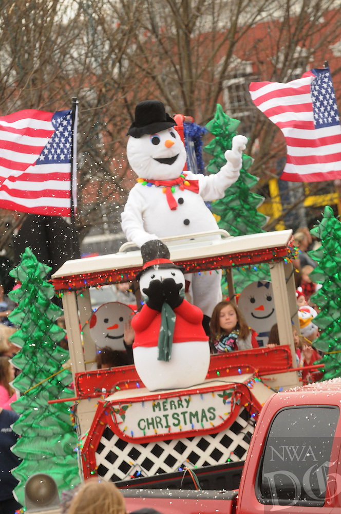NWA Democrat-Gazette/FLIP PUTTHOFF<br /> PARADE PAGEANTRY<br /> Frosty the Snowman was part of a float Saturday Dec. 12, 2015 at the Bentonville Christmas Parade. The parade featured floats, marching bands, classic cars and Santa Claus in downtown Bentonville. Hundreds packed the area around the square to watchthe Christmas parade.