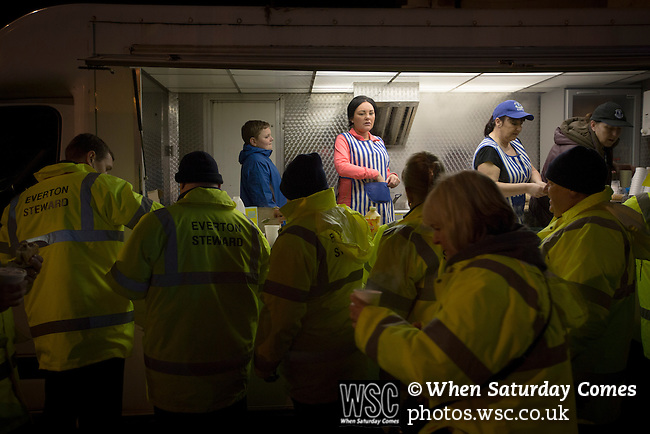 Everton 0 West Bromwich Albion 0, 19/01/2015. Goodison Park, Premier League. Stewards buying refreshments outside Goodison Park, Liverpool before the Premier League match between Everton and West Bromwich Albion. The match ended in a 0-0 draw, despite the home team missing a first-half penalty by Kevin Mirallas. The game was watched by 34,739 spectators and left both teams languishing near the relegation zone. Photo by Colin McPherson.
