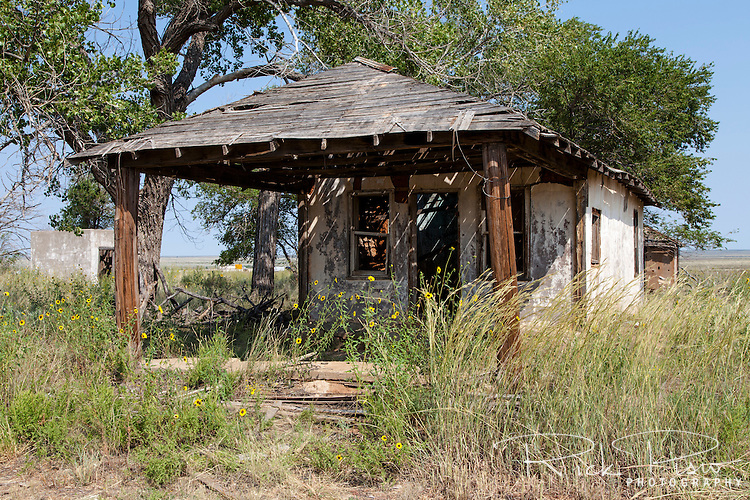 The abandoned Broyles Gas Station along Route 66 in Glenrio, New Mexico. The wood and adobe building was built in 1925 as a Mobil Gasoline franchise.  Glenrio straddled the Texas-New Mexico state line and thrived through the 40's, 50's, and 60's until the Interstate bypassed the town in 1975.