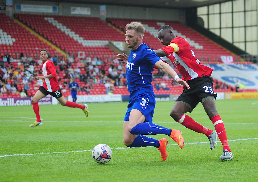 Chesterfield's Daniel Jones is fouled by Lincoln City's Nat Brown<br /> <br /> Photographer Chris Vaughan/CameraSport<br /> <br /> Football - Friendly - Lincoln City v Chesterfield - Saturday 19th July 2014 - Sincil Bank Stadium - Lincoln<br /> <br /> &copy; CameraSport - 43 Linden Ave. Countesthorpe. Leicester. England. LE8 5PG - Tel: +44 (0) 116 277 4147 - admin@camerasport.com - www.camerasport.com