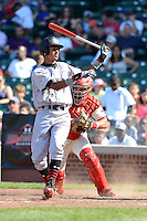 Catcher / First Baseman Chase Vallot (25) of St. Thomas More High School in Youngsville, Louisiana tags Jacob Gatewood for the out during the Under Armour All-American Game on August 24, 2013 at Wrigley Field in Chicago, Illinois.  (Mike Janes/Four Seam Images)
