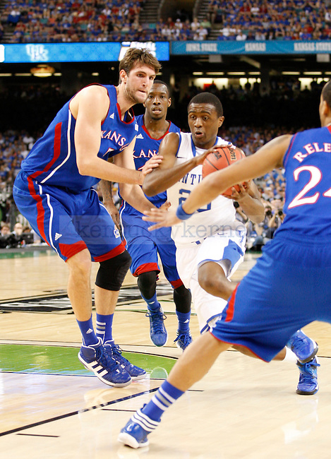 Doron Lamb being guarded in the first half of the championship game of the NCAA Tournament between the University of Kentucky and Kansas University, in the Superdome, on Monday, April 2, 2012 in New Orleans, La. Photo by Latara Appleby | Staff