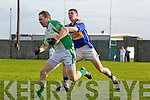 Darragh Kennelly of St Senans trys to stop the advance of Ballyduff's Paud Costello in his penalty in The Bernard O'Callaghan Memorial Senior Football Championship quarter final replay last Sunday in Bob Stack Park, Ballybunion.