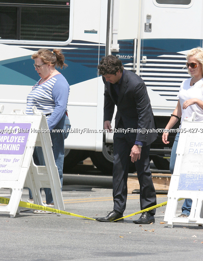 """Patrick Dempsey stumbling over Caution tape while filming """"Made of Honor"""" at the Westfield Mall in sherman Oaks."""