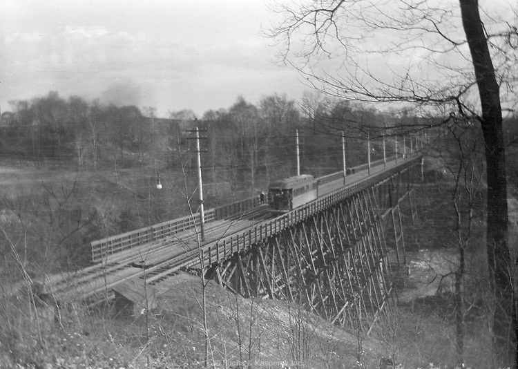 A streetcar crosses the newly opened bridge over the Cuyahoga River in Akron, Ohio. April 23, 1911