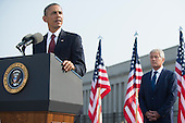United States President Barack Obama delivers remarks during a remembrance ceremony for the 12th anniversary of the 9/11 terrorist attacks, at the Pentagon on September 11, 2013 in Arlington, Virginia. U.S. Secretary of Defense Chuck Hagel is seen behind Obama. <br /> Credit: Kevin Dietsch / Pool via CNP