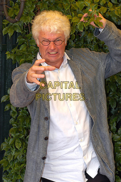 "JEAN JAQUES ANNAUD.Photocall for film ""I due Fratelli"".Hotel Eden, Rome, Italy, September 20th 2004.                            .half length funny growling claw hand bush.Ref: LUC.www.capitalpictures.com.sales@capitalpictures.com.©Capital Pictures."