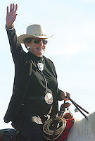 Grand Marshal Louise Serpa waves to the crowds as the parade makes its way down South Park Avenue from East Ajo Way. Serpa is a longtime rodeo photographer.