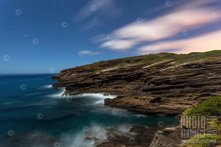 Sea cliffs against a starry evening sky near Hanauma Bay, East O'ahu.