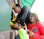 SIOUX FALLS, SD, MAY 20:  Justin Schneider and his kids Kenley, age 5, and Tate, age 3, purchase tickets for the Canaries game Friday night.  (Photo by Dave Eggen/Inertia)