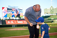 Former Chicago Cubs catcher David Ross signs a baseball after throwing out the first pitch before the Under Armour All-American Game presented by Baseball Factory on July 29, 2017 at Wrigley Field in Chicago, Illinois.  (Mike Janes/Four Seam Images)