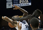 Nevada forward Jordan Caroline (24) is fouled by San Diego State forward Aguek Arop in the second half of an NCAA college basketball game in Reno, Nev., Saturday, Mar. 9, 2019. (AP Photo/Tom R. Smedes)