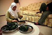 Turkish woman preparing stuffed cabbage leaves (lahana sarma) at home in an apartment in Turkey