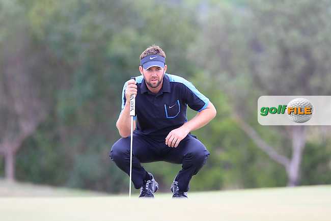 Scott Jamieson (SCO) on the 7th green during Saturday's Round 3 of the 2013 Portugal Masters held at the Oceanico Victoria Golf Club. 12th October 2013.<br /> Picture: Eoin Clarke www.golffile.ie