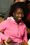 Education High School Public portrait of smiling female student in class looking at camera vertical
