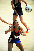 Kayla Cullen in action during the 2015 National Netball Championship match between Auckland (blue) and Christchurch (red and black) at ASB Sports Centre, Kilbirnie, Wellington, New Zealand on Tuesday, 29 September 2015. Photo: Dave Lintott / lintottphoto.co.nz