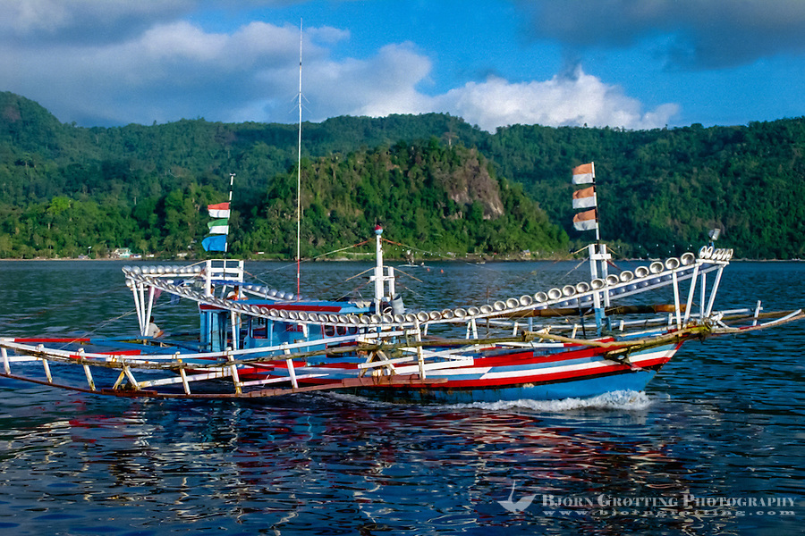 West Sumatra, Padang. Padang port, Teluk Bayur. Fishing boat on the way to sea for a nights work. Notice the large number of lanterns all around the boat.