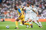 Vinicius de Oliveira Franco of APOEL FC runs past Carlos Henrique Casemiro of Real Madrid during the UEFA Champions League 2017-18 match between Real Madrid and APOEL FC at Estadio Santiago Bernabeu on 13 September 2017 in Madrid, Spain. Photo by Diego Gonzalez / Power Sport Images