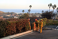 The Presbyterian church was totally burned and damaged in Malibu, California October 21, 2007. Firefighters watch the brush below. The wildfire fanned by powerful winds burned out of control on Sunday in the celebrity seaside enclave of  Malibu, forcing hundreds of people to flee and destroying a handful of multimillion-dollar homes. Photo by Nina Prommer/Milestone Photo.