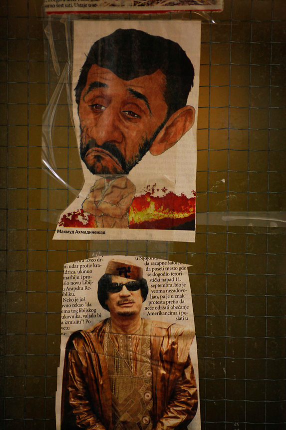 ATTN RUSSEL BOYCE*** PICTURES TO BE PROTECTED BEFORE RUSSEL CLEARS RELEASE***..Pictures from newspapers of Iran's President Mahmoud Ahmedinejad and ex Libyan leader Muammar Gadaffi are seen on the wall of a kitchen in one of the wings of the Detention Unit of the International Criminal Tribunal for the former Yugoslavia (ICTY) in Hague September 20, 2011. While awaiting or undergoing trial, around 40 people from the former Yugoslavia of different ethnic and religions accused of war crimes spend their time in peace and harmony at the detention unit of ICTY located within a Dutch prison complex in the Scheveningen neighborhood of Hague.  REUTERS/Damir Sagolj (NETHERLANDS)
