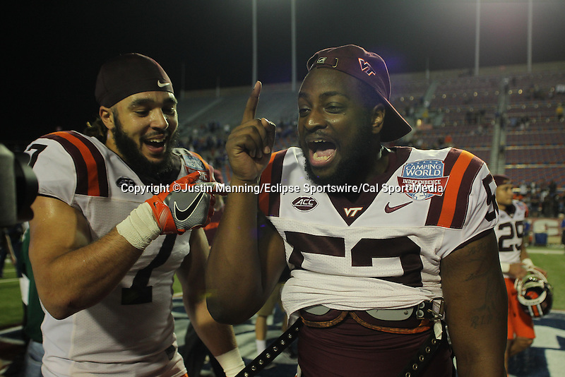 December 26, 2015: Virginia Tech players celebrating after winning the Camping World Independence Bowl at Independence Stadium in Shreveport, LA. Justin Manning/ESW/CSM