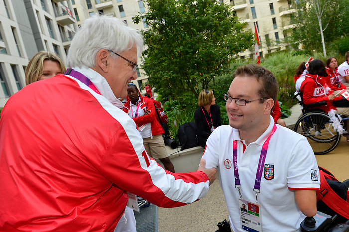 LONDON, ENGLAND 26/08/2012 - Gordon Campbell, Canadian High Commissioner to Great Britain, shakes hands with Josh Vander Vies of Boccia during a pep rally at Canada House at the London 2012 Paralympic Games. (Photo: Phillip MacCallum/Canadian Paralympic Committee)