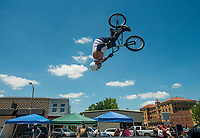 NWA Democrat-Gazette/BEN GOFF @NWABENGOFF<br /> Cody Juarez of Rogers does a backflip Saturday, July 7, 2018, at a Southern BMX Stunt Show performance during The Natural State Criterium Series in downtown Rogers. The third annual series produced by BikeNWA began with races in downtown Bentonville Friday evening. The series concludes Sunday in downtown Springdale with the first event starting at 8:50 a.m. and the final event starting at 4:00 p.m.