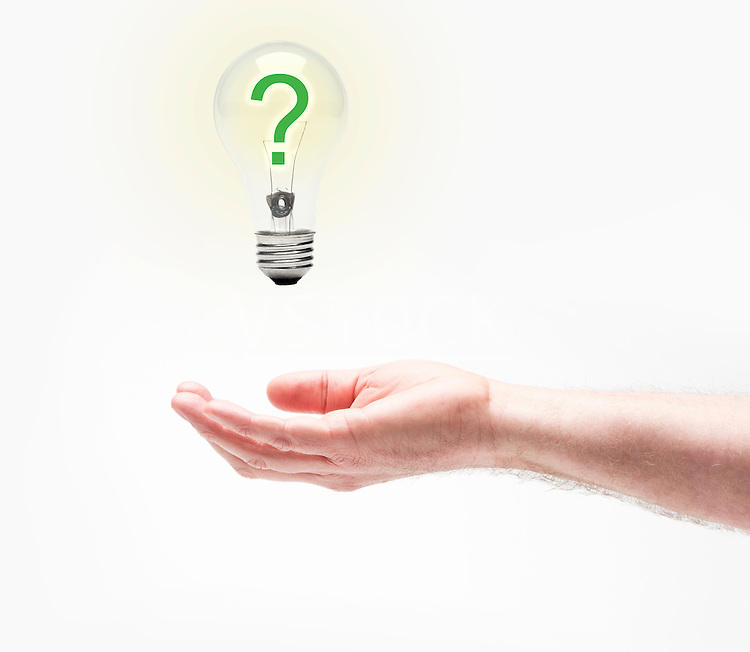 Studio shot of hand holding light bulb with question mark inside