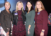 NWA Democrat-Gazette/CARIN SCHOPPMEYER Melody Richard (from left); Julie Barber, Signature Chefs co-chairwoman; Dianna Marshall; and Heather McIntye, co-chairwoman visit at the March of Dimes benefit.