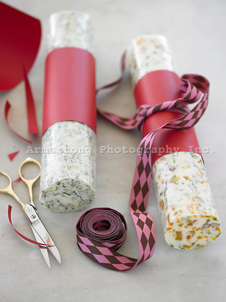 Rolls of compound (flavored) butter, wrapped in wax paper and tied with ribbon as a gift.
