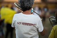 """We Resist!<br /> <br /> Rome, 05/07/2020. Today, thousands of people gathered in Piazza San Giovanni to attend the """"Stati Popolari"""". The rally, organised by Aboubakar Soumahoro (1.) - Trade Union Coordinator of the Unione Sindacale di Base USB, was meant to be a popular answer by the """"Invisibles"""" to the """"Stati Generali dell'Economia"""" (States General of the Economy, 2.) of the Italian Prime Minister Giuseppe Conte, a 10-day-long meeting held in June at Villa Doria Pamphili (Villa Doria Pamphilj, 2.) where Italian and EU leaders / members of Governments, bankers, investors, advisors, met to discuss the economic recovery from the Covid-19 / Coronavirus crisis. From the organisers Facebook event page: «The Popular States will be our agora, where different realities will bring their pains and their proposals. A human square to make all the invisible visible and to give voice to all the unheard, our only symbol. The Popular States will be the communion of our needs and our struggles […]» (3.). At the end of the demo Soumahoro, who mainly deals with protection of """"Braccianti"""" (agricultural workers) rights, fights against """"caporalato"""" (illegal hiring) and the exploitation along the agricultural supply chain, gave a speech (4.) addressing the requests to the Government: - National plan for the work emergency; - Public housing program; - integral reform of the food supply chain; - radical transformation of migration policies (including, the """"right to return"""" for Italian migrants); - abolish the """"Security decrees"""" and cancel Bossi-Fini law; - reform the reception; - ecological transition strategy; - proactive interventions against discrimination and for equality.<br /> <br /> Footnotes & Links:<br /> 1. (Wikipedia.org) http://bit.do/fF4rH<br /> 2. 16.06.20 Aboubakar Soumahoro: Hunger/Thirst Strike And Meeting With Italian Prime Minister Conte http://bit.do/fGrbH<br /> 3. http://bit.do/fGrbD & https://www.facebook.com/StatiPopolari/<br /> 4. Aboubakar Soumahoro Speech: http://b"""