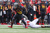 College Park, MD - November 26, 2016: Maryland Terrapins running back Kenneth Goins Jr. (30) breaks a tackle during game between Rutgers and Maryland at  Capital One Field at Maryland Stadium in College Park, MD.  (Photo by Elliott Brown/Media Images International)