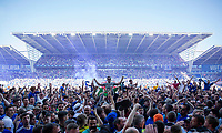 Cardiff City fans celebrate their side's promotion to the Premier League on the pitch after the Sky Bet Championship match between Cardiff City and Reading at the Cardiff City Stadium, Cardiff, Wales on 6 May 2018. Photo by Mark  Hawkins / PRiME Media Images.