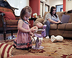 Sophia, 2, her doll and her mother. Beaufort, South Carolina.
