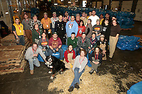 33 volunteers who bagged, palletized and added postage to 1500 bales of straw at Airland Transport in Anchorage to be sent out to the 22 checkpoints along the Iditarod trail pose for a picture together Thursday, Feb. 7, 2013.