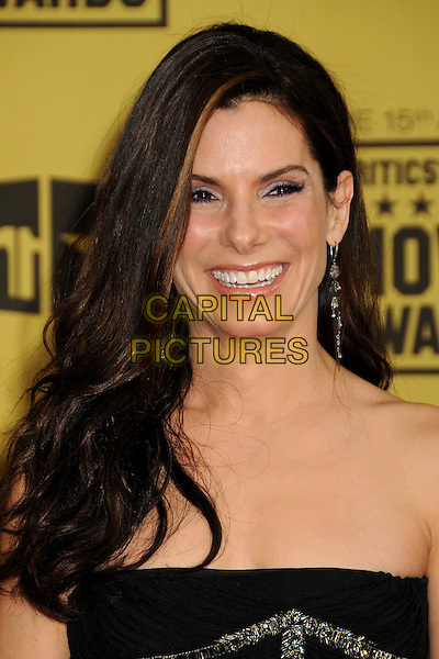 SANDRA BULLOCK.15th Annual Critics' Choice Movie Awards - Arrivals held at the Hollywood Palladium, Hollywood, California, USA, 15th January 2010..portrait headshot black strapless smiling dangly earring .CAP/ADM/BP.©Byron Purvis/Admedia/Capital Pictures