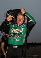 Aug 17, 2014; Brainerd, MN, USA; NHRA funny car driver John Force reacts during the Lucas Oil Nationals at Brainerd International Raceway. Mandatory Credit: Mark J. Rebilas-