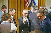 Foreign Minister Moshe Dayan of Israel waves to an unidentified person prior to the signing ceremony for the Camp David Agreement in the East Room of the White House in Washington, D.C. on Sunday, September 17, 1978.  National Security Advisor Zbigniew Brezezinski looks on from left..Credit: Arnie Sachs / CNP