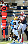 SIOUX FALLS, SD - SEPTEMBER 2: Damon Gibson #9 from the University of Minnesota Morehead leaps to catch the ball over Jordan Johnson #21 from Augustana for a touchdown in the first half of their game Saturday afternoon at Augustana University. (Photo by Dave Eggen/Inertia)