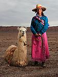 Chilean woman with lama in the Atacama Desert near San Pedro de Atacama, Chile.