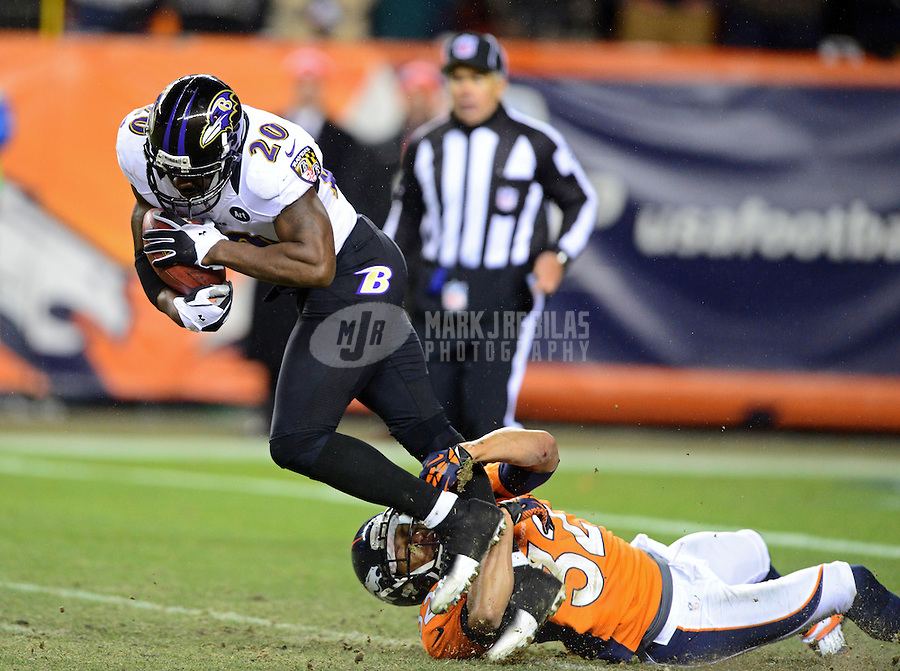 Jan 12, 2013; Denver, CO, USA; Baltimore Ravens safety Ed Reed (20) is tackled by Denver Broncos cornerback Tony Carter (32) during the AFC divisional round playoff game at Sports Authority Field.  Mandatory Credit: Mark J. Rebilas-