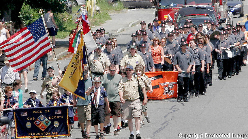 Stoughton Cub Scouts and Stoughton High School Band March up Washington Street during the Stoughton Memorial Day parade on Monday, May 28, 2012. (Photo by Gary Wilcox).