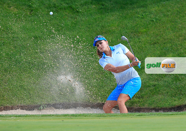 Lexi Thompson (USA) chips from a bunker at the par3 16th green during Sunday's Final Round of the LPGA 2015 Evian Championship, held at the Evian Resort Golf Club, Evian les Bains, France. 13th September 2015.<br /> Picture Eoin Clarke | Golffile