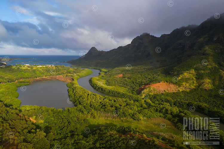 An aerial view of Menehune Fishpond, Huleia Stream and Nawiliwili town, Kaua'i; a slight rainbow can be seen on the right.