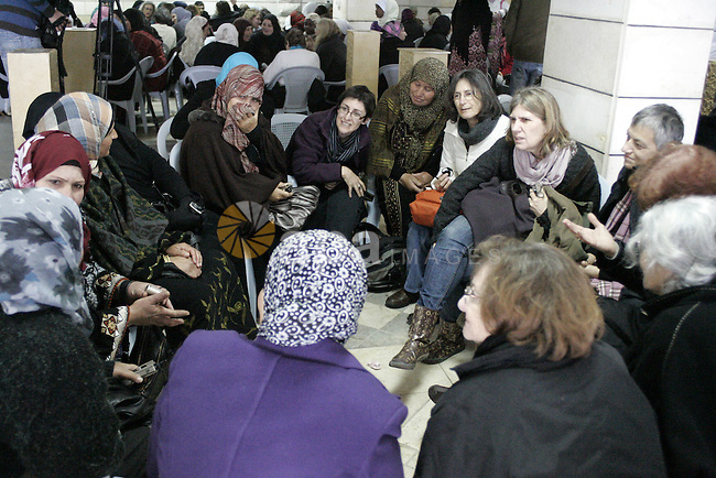 Palestinian and israeli women take part in a Palestinian_Jewish conference of the occasion of the 100th International Womens Day on March 12,2011 in Beit Omar village near the West Bank city of Hebron. Photo by Najeh Hashlamoun ..