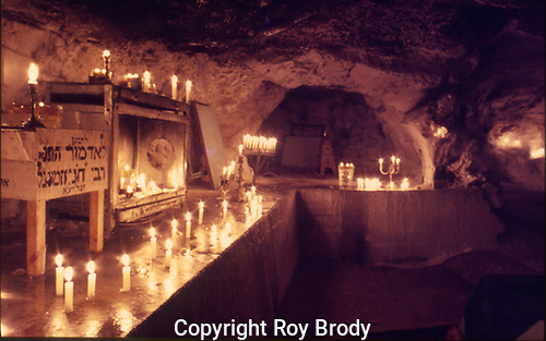 Interior of cave, showing lit candles, in the shrine of Honi haMa'agel, Upper Galilee.