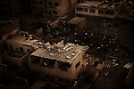 Baghdad, Iraq  : Mon 25th Dec 2009 :...Rescue workers sift through rubble after  bomb explosion at the Hamra hotel. Devastating bomb attacks struck four hotels around the Iraqi capital,  killing at least 37 in the Iraqi capital on Monday evening..Ayman Oghanna
