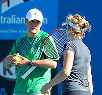Kim Clijsters practising at Melbourne Park with her coach Carl Maes...19/01/2012, 19th January 2012, 19.01.2012..The Australian Open, Melbourne Park, Melbourne,Victoria, Australia.@AMN IMAGES, Frey, Advantage Media Network, 30, Cleveland Street, London, W1T 4JD .Tel - +44 208 947 0100..email - mfrey@advantagemedianet.com..www.amnimages.photoshelter.com.