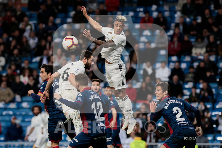 Real Madrid's Mariano Diaz and SD Huesca's Samuele Longo during La Liga match between Real Madrid and SD Huesca at Santiago Bernabeu Stadium in Madrid, Spain. March 31, 2019. (ALTERPHOTOS/A. Perez Meca)